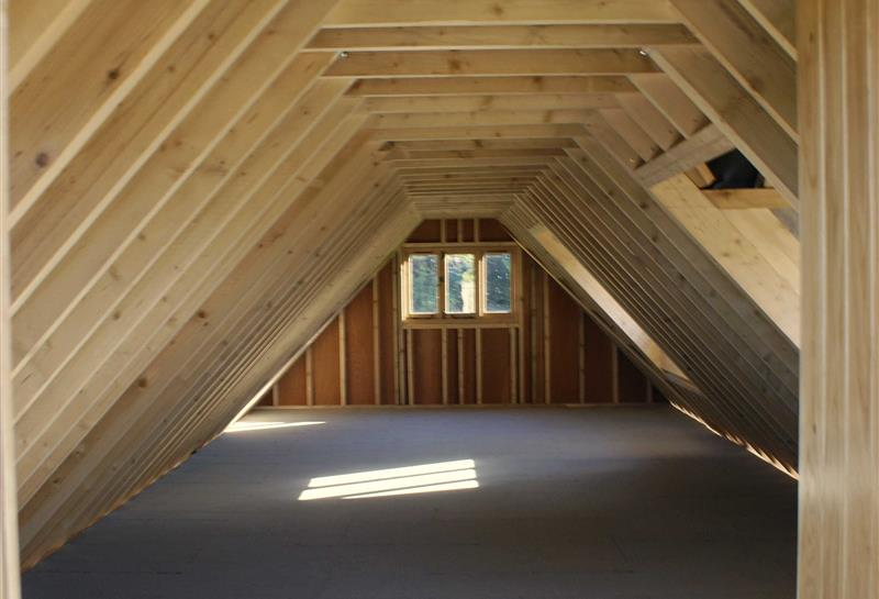 upstairs shell with exposed rafters & stud work prior to insulation and plasterboard